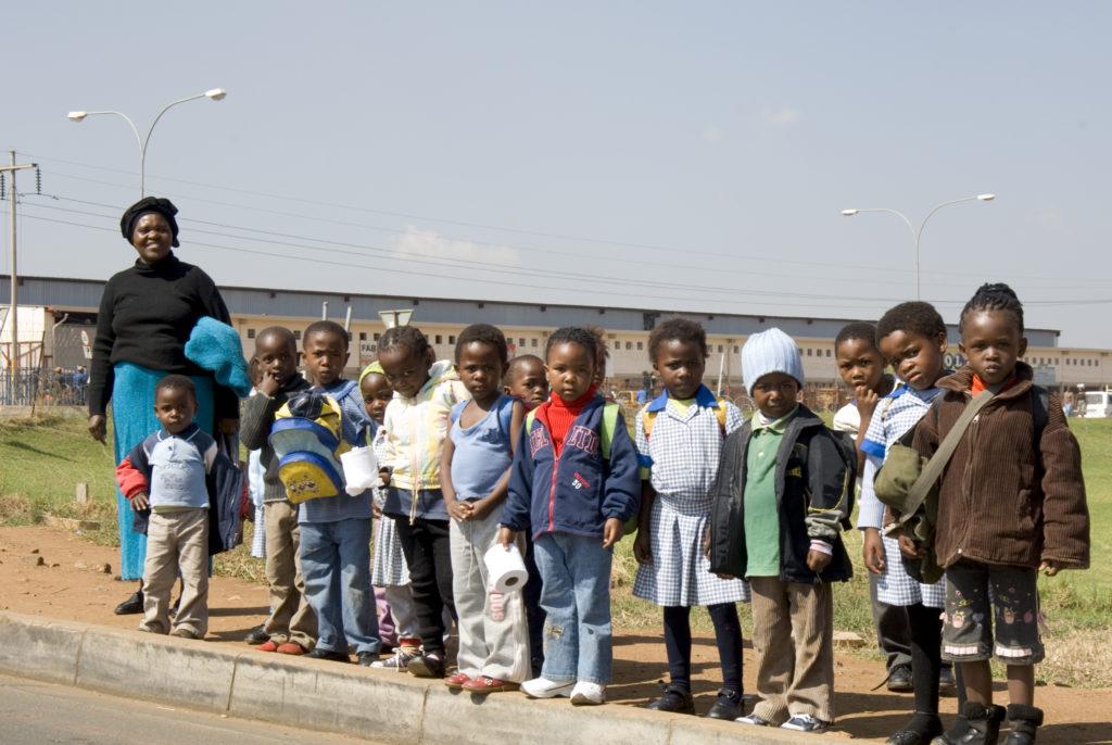 Children return to their homes in Kliptown, Soweto, after daycare