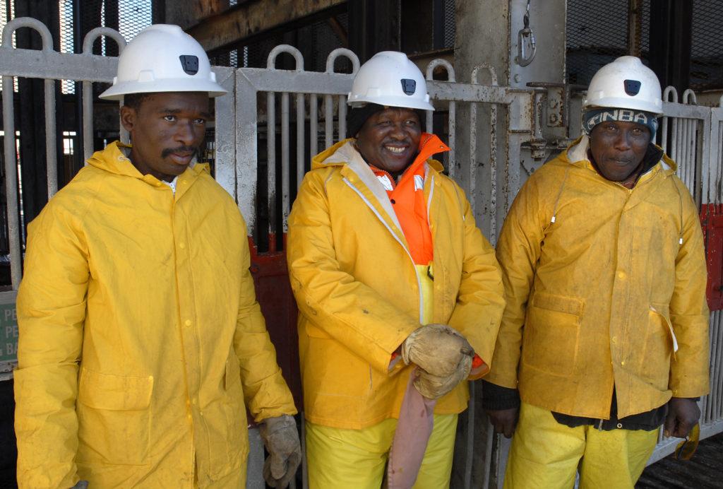 Cage assistants (from left) Moeketsi Momlekoa, Ndlaka Mtano and Bless Hamilton at the shaft at Harmony Gold Mine