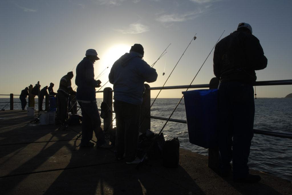 Durban, KwaZulu-Natal province: Fishermen on a pier