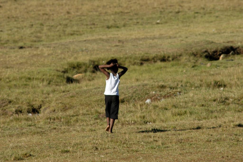 A little girl walks through the fields near Qunu