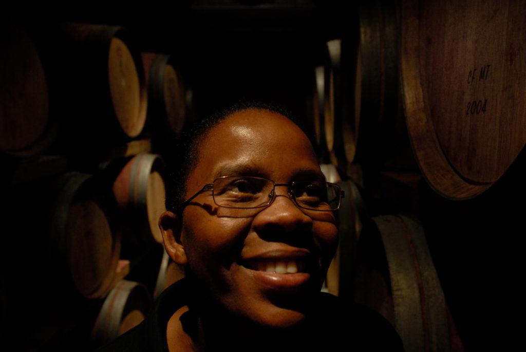 Ntsiki Biyela, winemaker at Stellakaya Cellars, among barrels of maturing wine