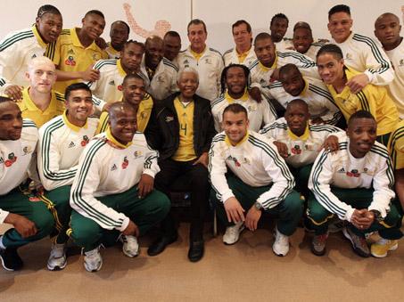 Statesman and former president Nelson Mandela with Bafana Bafana, South Africa's national football squad, at the Nelson Mandela Foundation in Johannesburg